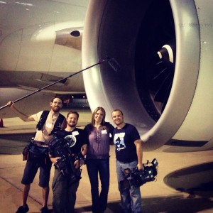 Michael McQueen, Dave Baker, Alix Jones, and I pose in front of Tripple 7 jet engine.