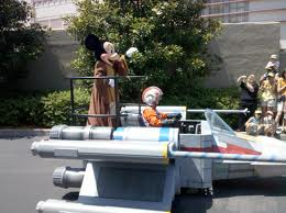 Mickey rides an X Wing Fighter
